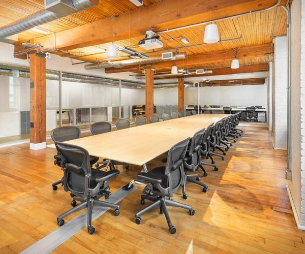 Office with high tech boardroom table and Aeron Chairs
